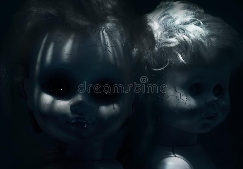 Two scary plastic cracked dolls royalty free stock photos