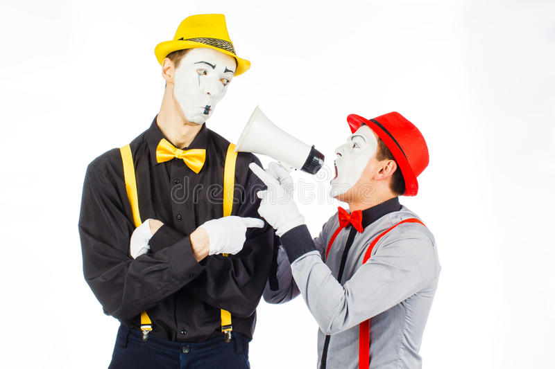 Two clown, MIME, flashy Megaphone. The expression of emotions. stock image