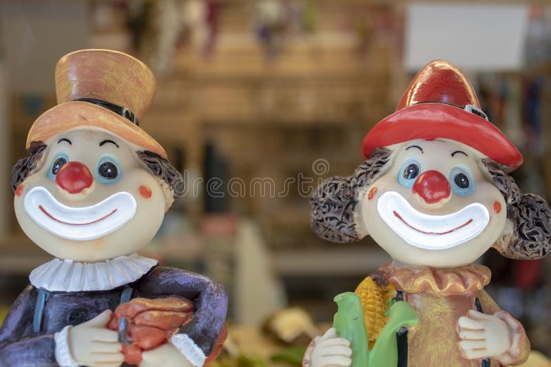 Two clowns. Faces close-up. Blurred background royalty free stock images