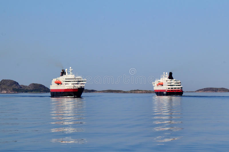 Two coastal steamer crossing. In front of Bolga, Arctic Norway royalty free stock photography