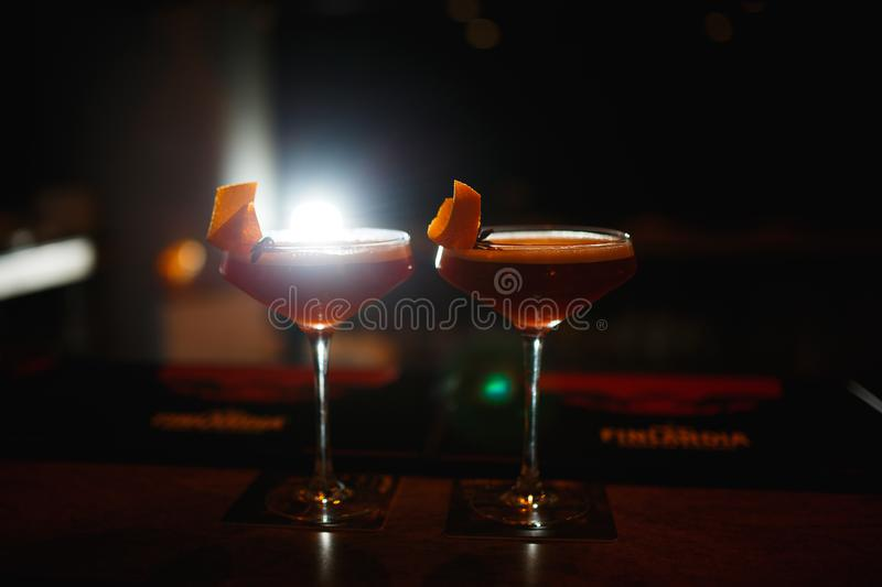 Two cocktails at the bar. Dark key photo.  royalty free stock images