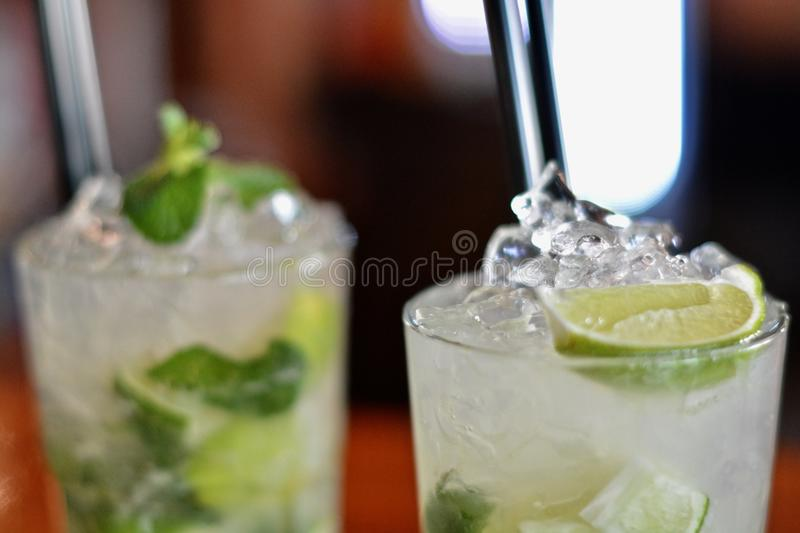 Two cocktails with mint and lime royalty free stock photo