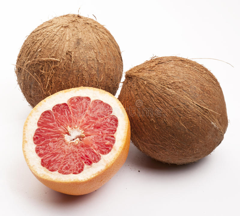 Two Coconuts And A Grapefruit Royalty Free Stock Photos