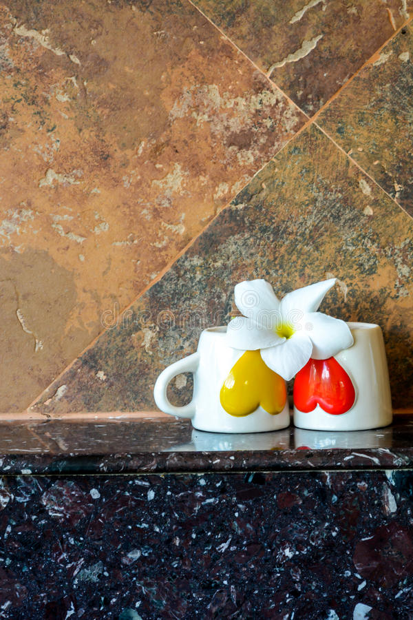Two coffee cups with a Flower. On top,selective focus stock images