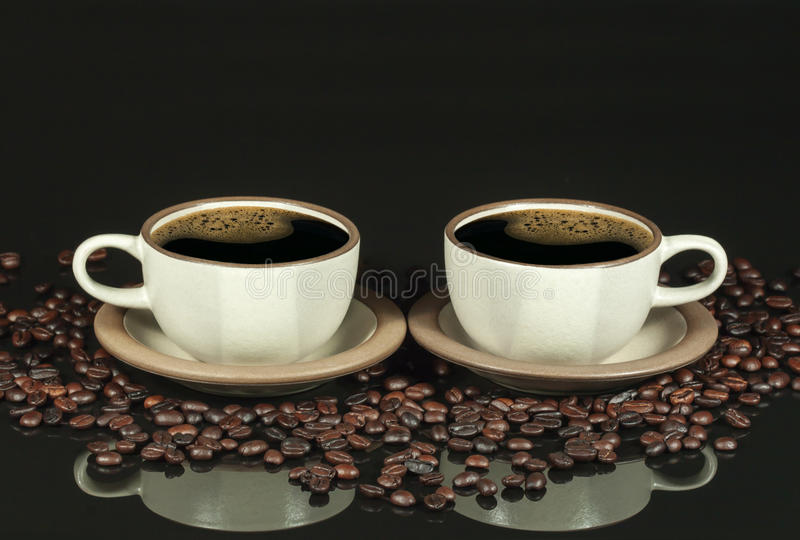 Two Coffee Cups Mirror Image royalty free stock photography