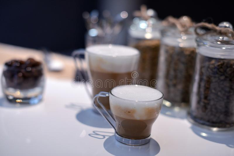 Two coffee espresso coffees with natural grains stock images
