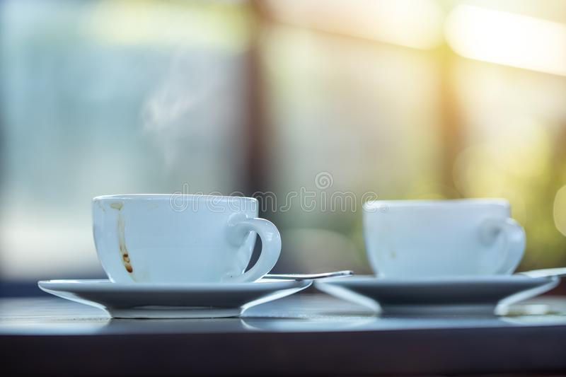 Two coffee mug on the table in the morning cafe. Meeting and talking together concept royalty free stock images