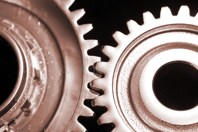 Two cogs stock photography