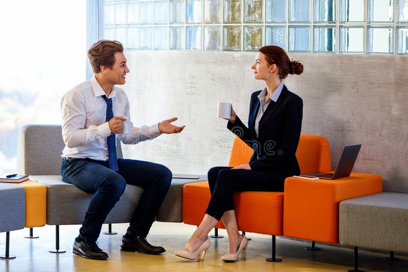 Two colleagues chatting on coffee break. royalty free stock photography