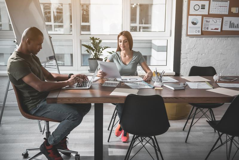Two colleagues concentrated on their working tasks royalty free stock photography