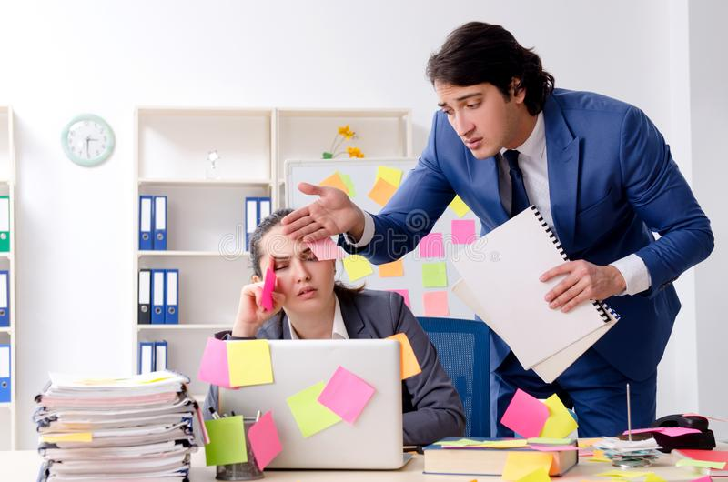 The two colleagues employees working in the office stock image