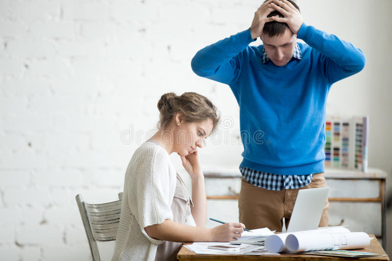 Two colleagues feeling troubled at work royalty free stock photos