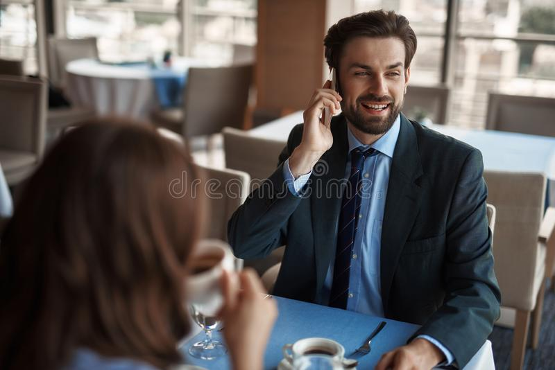 Two colleagues having business meeting in restaurant stock image