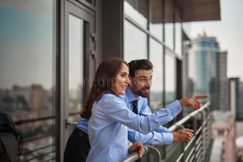 Two colleagues looking at something far away royalty free stock images
