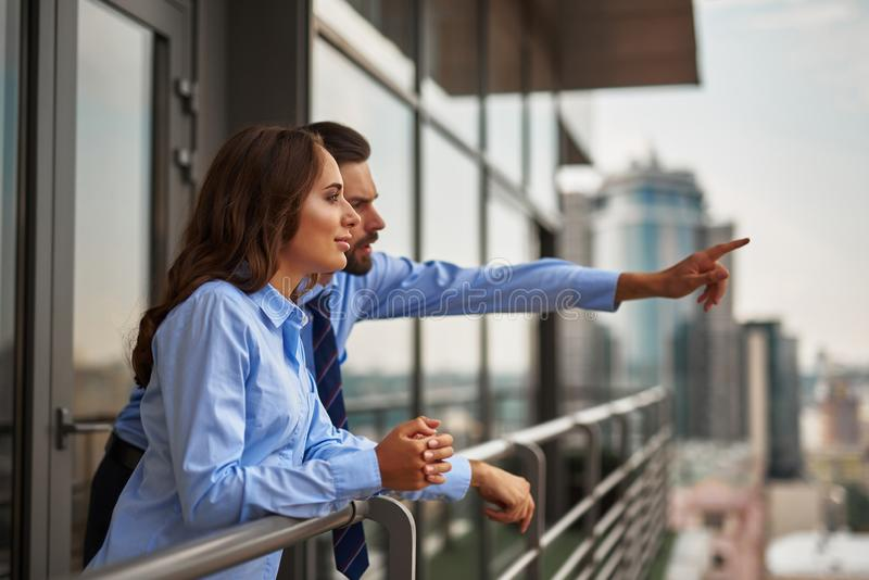 Two colleagues looking at something far away royalty free stock photography