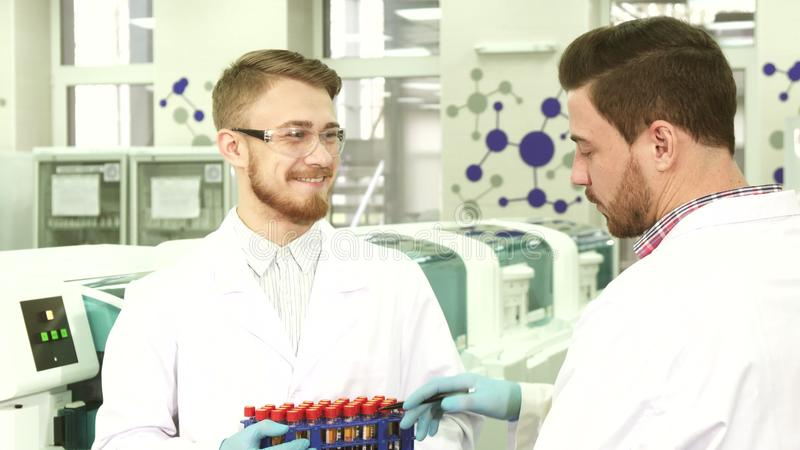 Colleagues in the laboratory discuss the results of their activities stock photo