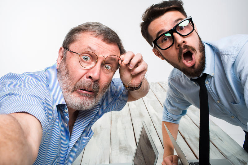 Two colleagues taking the picture to them self sitting in office stock photography