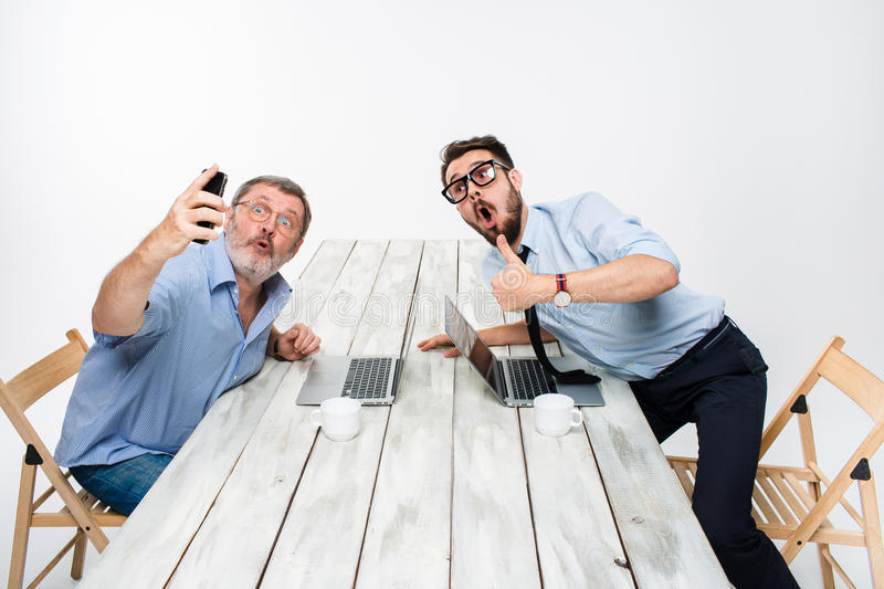 Two colleagues taking the picture to them self sitting in office stock photos