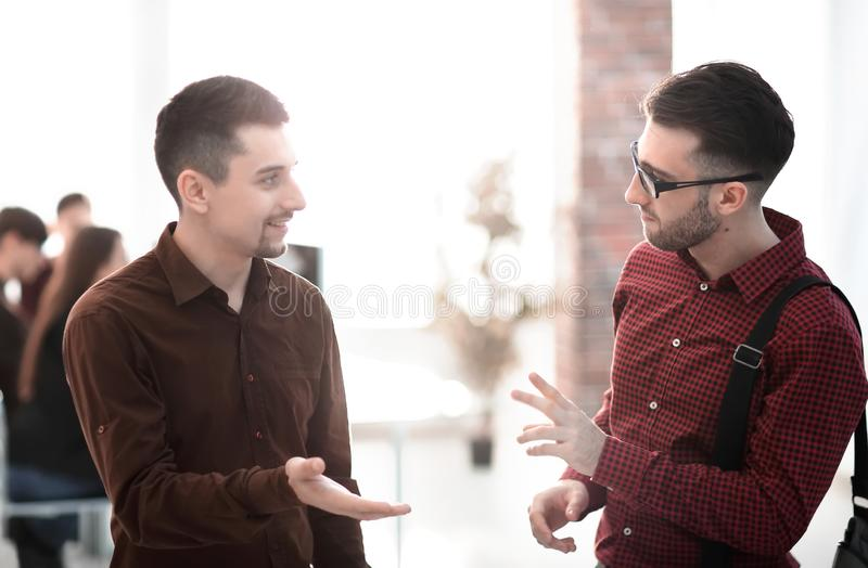 Two colleagues talking in office stock photos