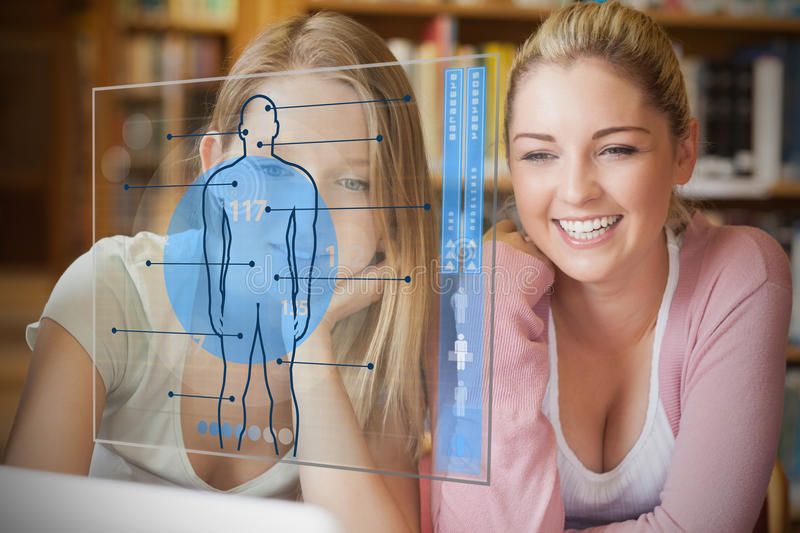 Two college students looking at laptop and futuristic interface. With body diagram in blue royalty free illustration