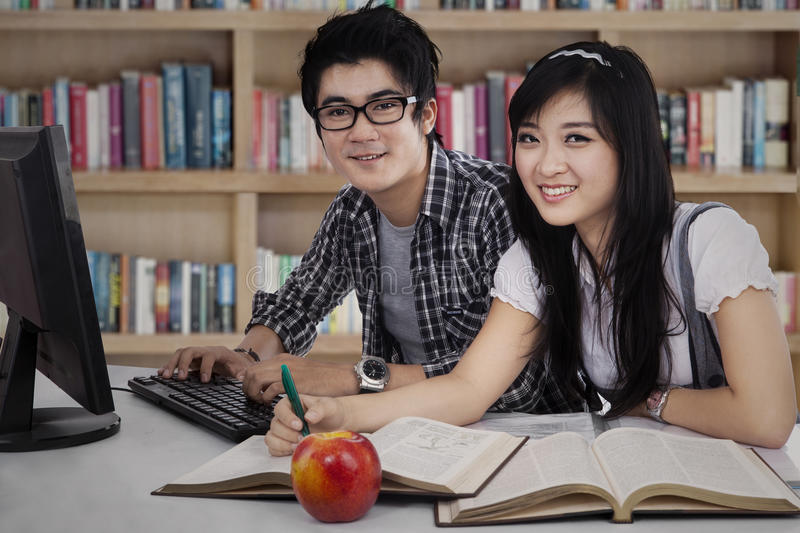 Two college students studying together stock image