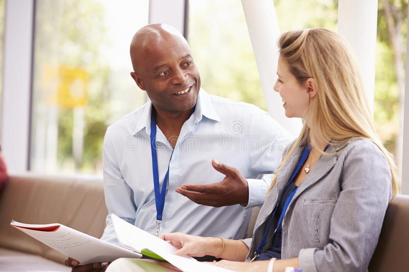 Two College Tutors Having Discussion Together royalty free stock photography