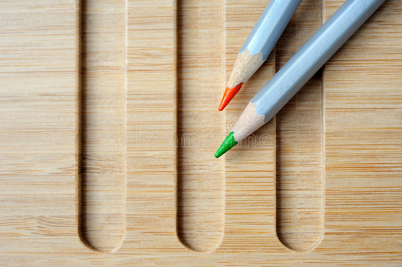 Two color pencil composition still life. Two Color pencil on wooden background royalty free stock photography