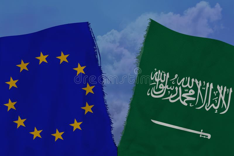 Two colored flags on torn fabric, a symbol of international relations of the European Union and Saudi Arabia, the concept of. Global business, the deterioration royalty free stock image