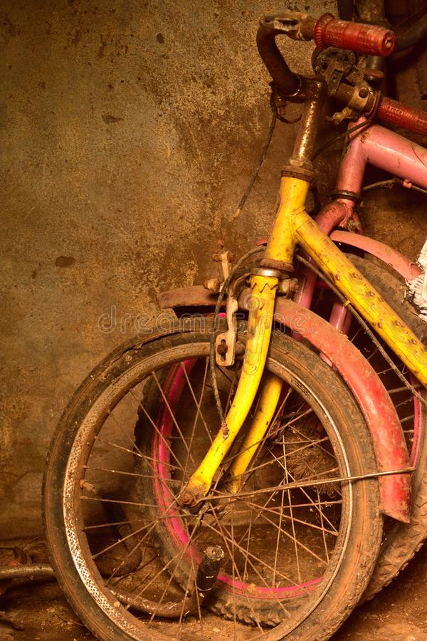 Two old colorful cycle for kids royalty free stock photo