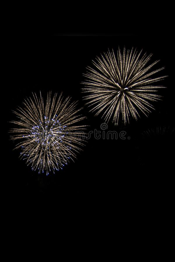 Two colorful fireworks on black background for cut out. royalty free stock photography