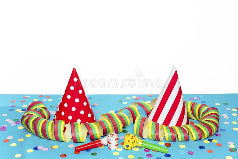 Two colorful hats. And confetti stock photo