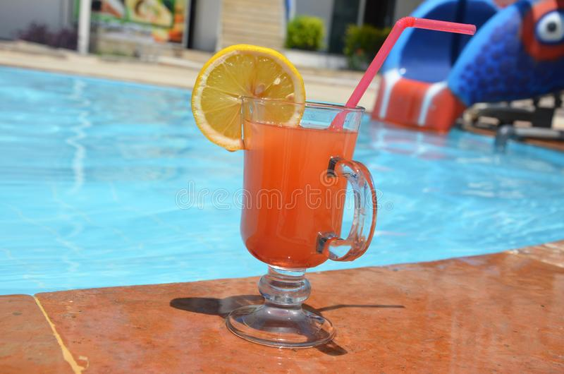 Two Colorful Tropical Cocktails near the Swimming Pool on the Background of Warm Blue Sea. Exotic Summer Vacation. royalty free stock photos