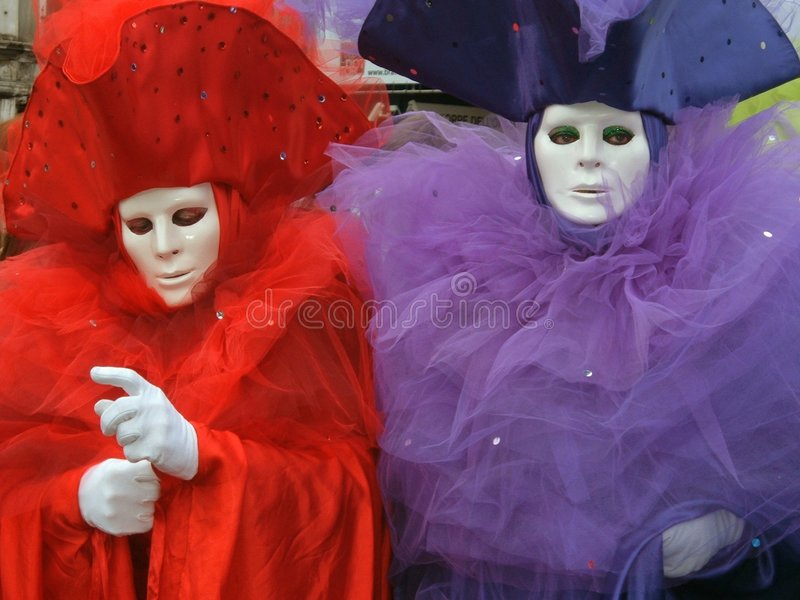 Two coloured masks in Venice stock photography
