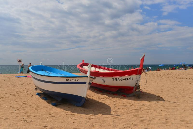 Two colourful old fish boats in Malgrat de Mar, Catalunya, Spain stock photos