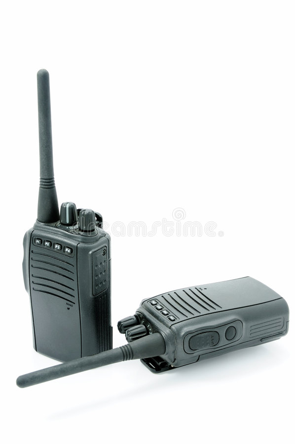 Two compact professional portable radio sets. Two black compact professional portable radio sets stock photo