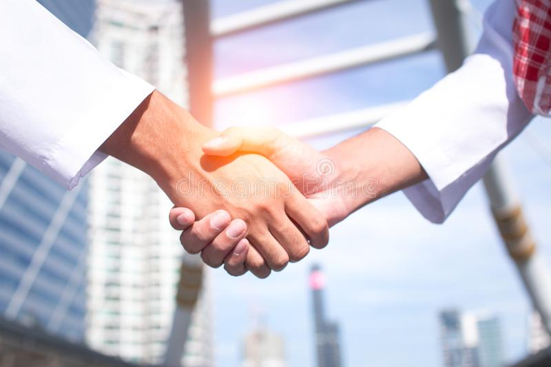 Two confident arab businessman shaking hands. Successful business partners. Negotiating business. royalty free stock photos