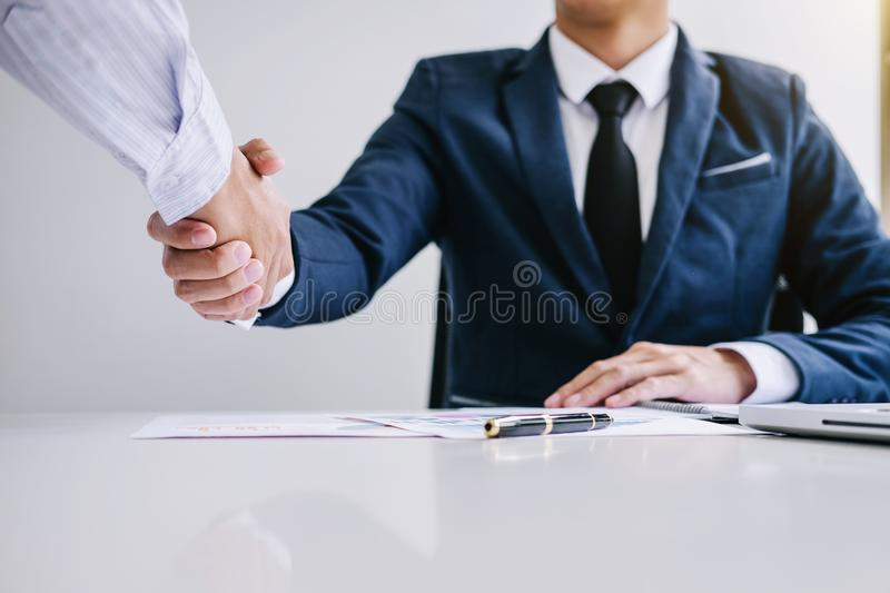 Two confident Business handshake and business people after discussing good deal of Trading contract and new projects for both com stock photography