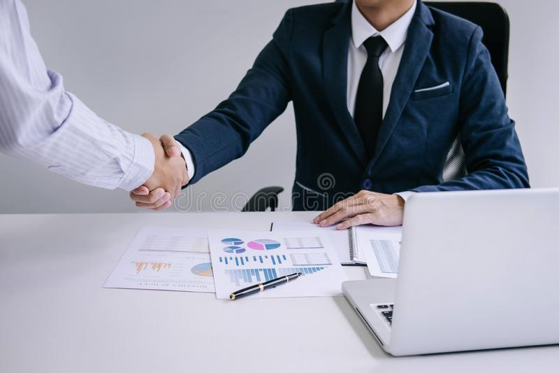 Two confident Business handshake and business people after discussing good deal of Trading contract and new projects for both. Companies royalty free stock image