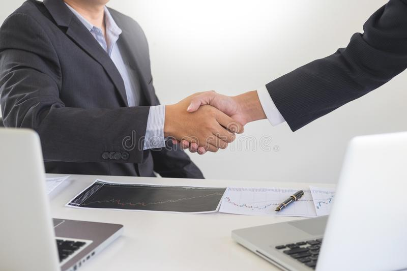 Two confident business man shaking hands during a meeting in the office, success, dealing, greeting and partner concept royalty free stock image