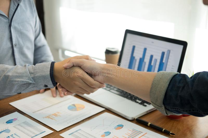 Two confident business man shaking hands during a meeting in the office, success, dealing, greeting and partner concept royalty free stock photo