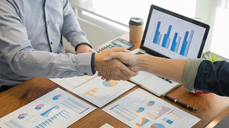 Two confident business man shaking hands during a meeting in the office, success, dealing, greeting and partner concept royalty free stock photos