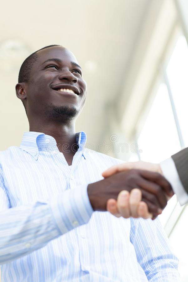 Two confident business man shaking hands during a meeting in the office, success, dealing, greeting and partner concept. stock image