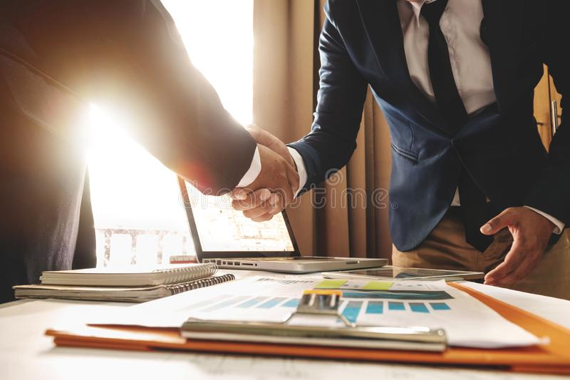 Business man shaking hands during a meeting in the office,. Two confident business man shaking hands during a meeting in the office, success, dealing, greeting royalty free stock photography