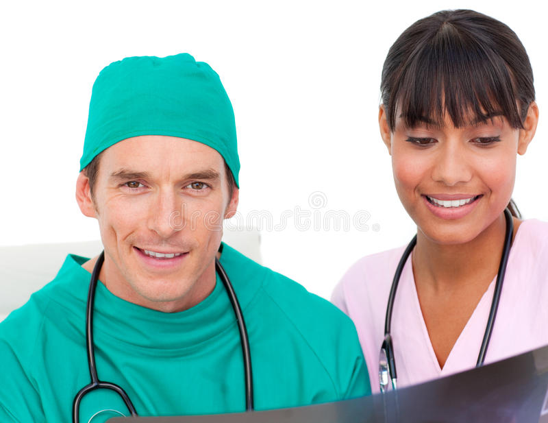 Two confident doctors looking at an X-ray royalty free stock photos