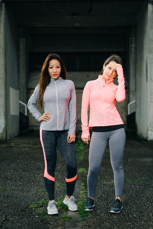 Two confident and motivated fitness women royalty free stock photography