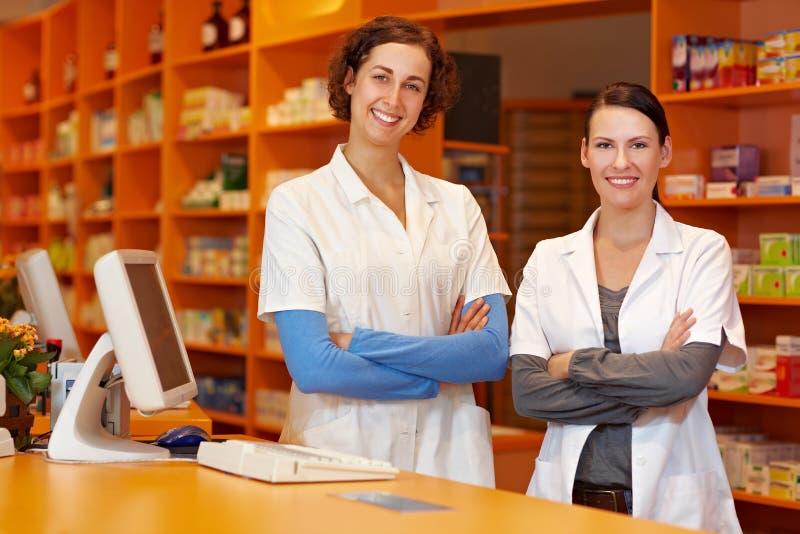 Two confident pharmacists stock photo