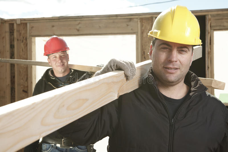 Two construction men working outside royalty free stock photography