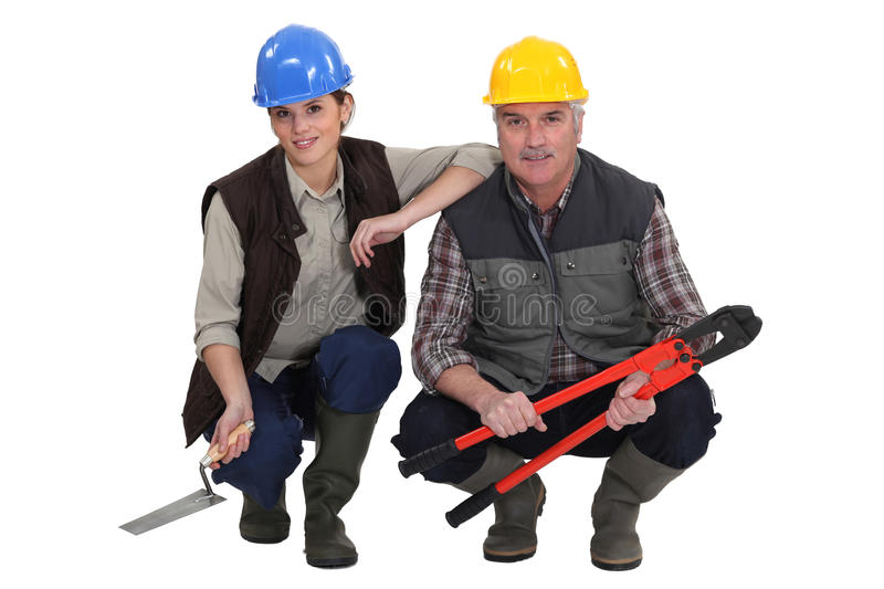 Two construction workers.