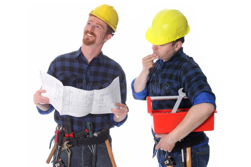 Two construction workers with architectural plans stock photography