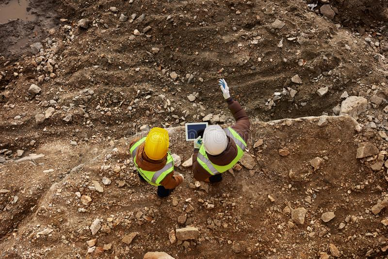 Two Construction Workers Inspecting Site royalty free stock image